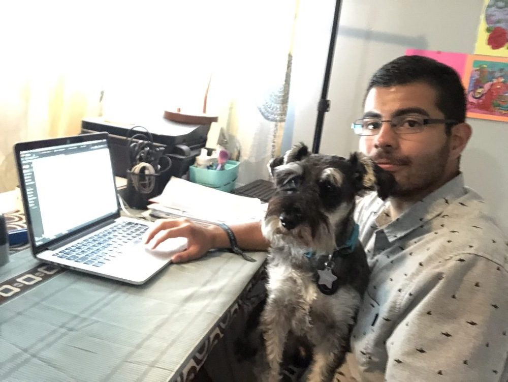 Efrain and toby working hard from the home office